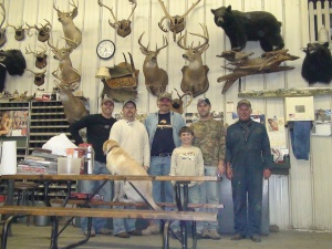 "The ""game wall"" at my dad's shop is a reminder of his hunting passion. He's far right. The fellowship of family trumped the hunting later in his outdoor hobby"