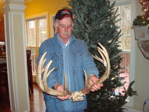Dad admiring my 2010 Illinois buck while on a visit to our house.